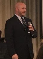 Dennis speaking